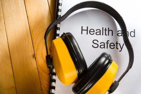 health industry: Health and safety register with earphones