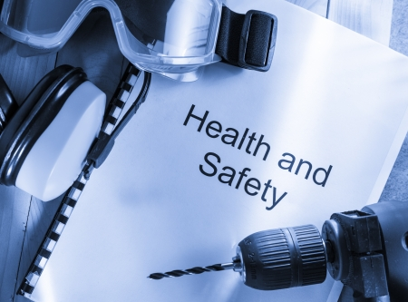 work safety: Health and safety Register with goggles, drill and earphones