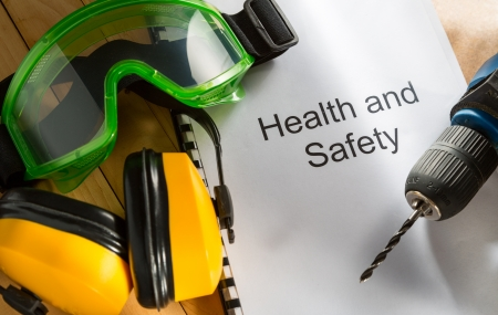 Health and safety Register with goggles, drill and earphones photo