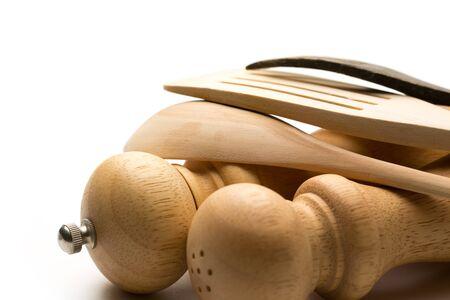 Wooden salt and pepper set with kitchen utensils photo