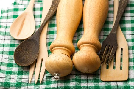 Wooden salt and pepper set with spoon photo