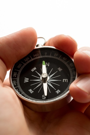 Hand holding silver black compass photo