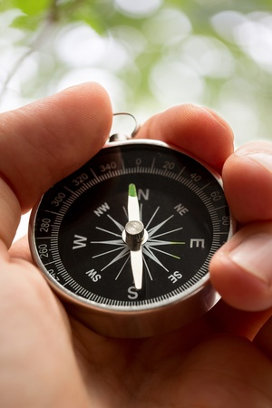 Hand holding silver black compass Stock Photo - 15495533
