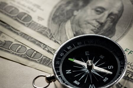 Silver black compass with dollars Stock Photo - 15516430