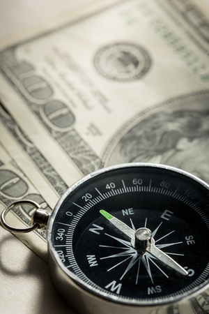 Silver black compass with dollars Stock Photo - 15516305