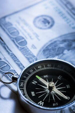 Silver black compass with dollars Stock Photo - 15516363