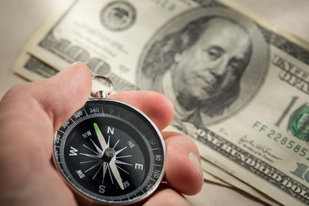 Hand holding silver black compass Stock Photo - 15516314