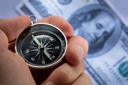 Hand holding silver black compass Stock Photo - 15516397