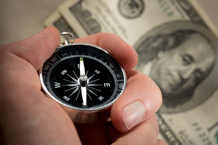 Hand holding silver black compass Stock Photo - 15516306