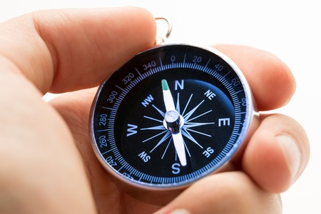 Hand holding silver black compass Stock Photo - 15425428