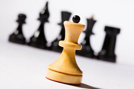 Black and white chessmen on white  Stock Photo