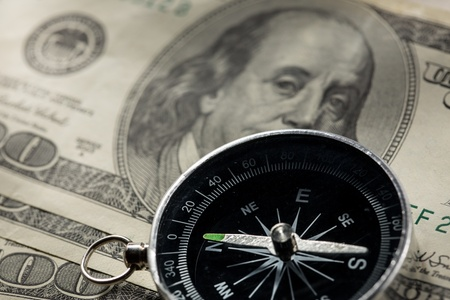 Silver black compass with money Stock Photo - 16029313