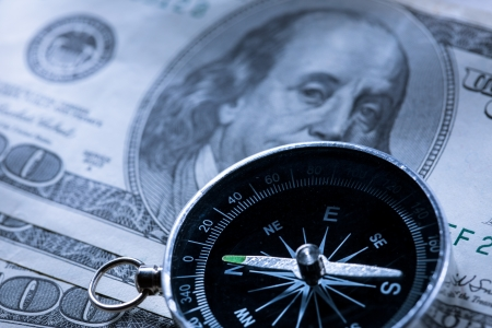 Silver black compass with money Stock Photo