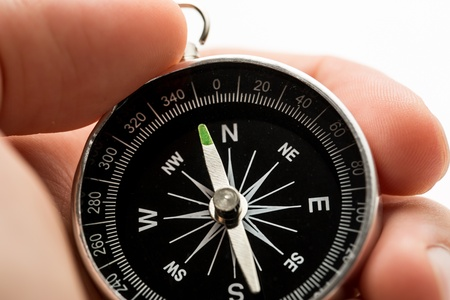 Hand holding silver black compass Stock Photo - 16029343