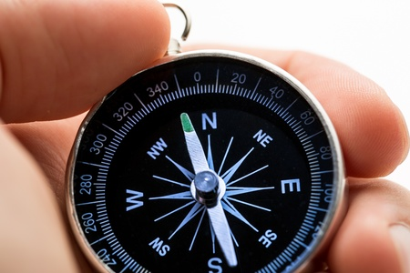Hand holding silver black compass Stock Photo - 16029322