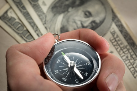 Hand holding silver black compass Stock Photo - 16029293