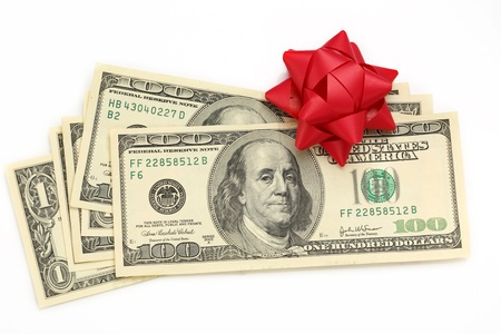 Dollars with decorative bow on white Stock Photo - 16241276