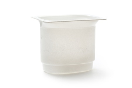 Empty plastic yoghurt pot on white photo