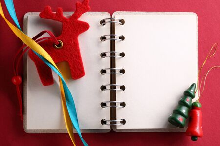 compliment: Open notebook with ribbons and reindeer