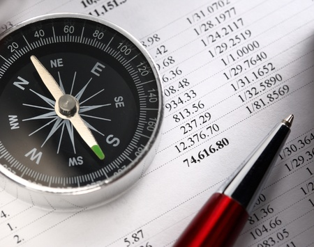 Operating budget, compass and pen photo