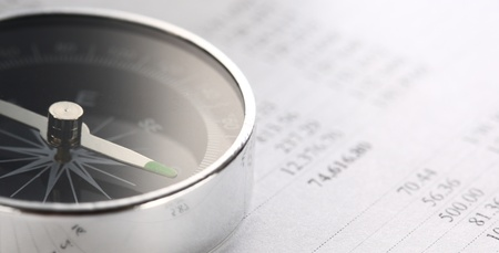 Operating budget and black compass Stock Photo - 16445157