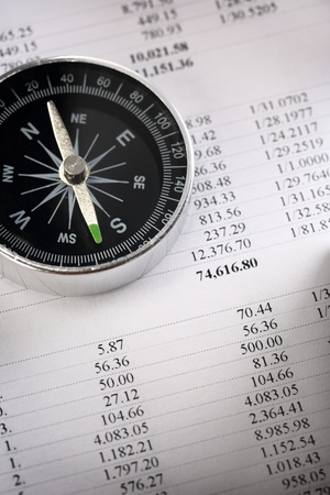 Operating budget and black compass Stock Photo - 16445260