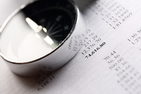 Operating budget and black compass Stock Photo - 16445218