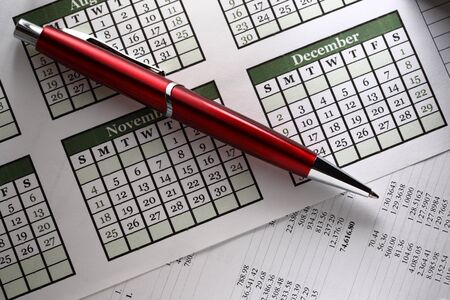monthly salary: Operating budget, calendar and pen Stock Photo