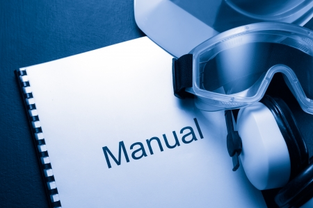 Manual with helmet, goggles and headphones Stock Photo