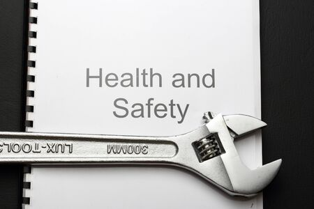 Health and safety register with spanner  photo