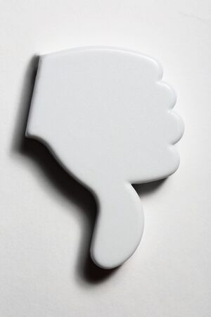 contradict: Thumb down negative sign badge Stock Photo