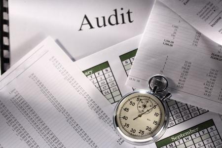 financial paperwork: Operating budget, calendar, stopwatch and audit