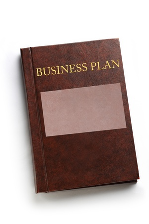 Business plan book on white Stock Photo - 17621352