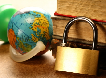 keylock: Pile of old books, globe and keylock
