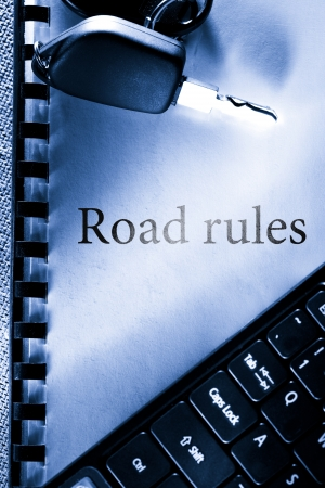Road rules, car key and computer keyboard photo