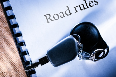 Road rules and car key Stock Photo - 17910031