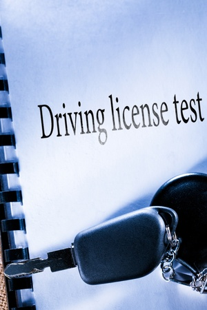 Testbook and car key Stock Photo - 17910023