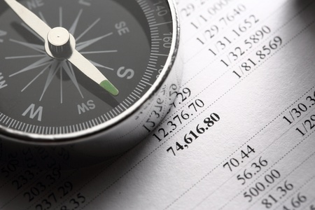 financial gains: Operating budget and black compass  Stock Photo