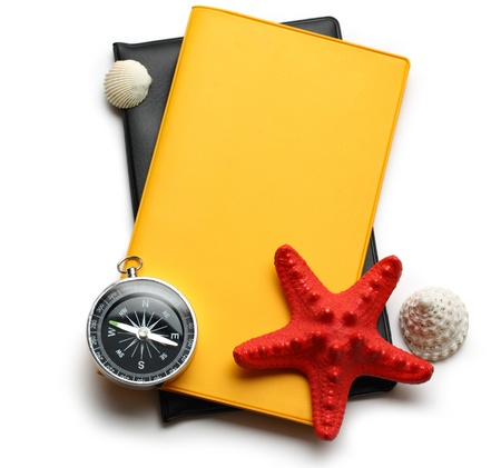 Compass, seastar and seashells on notebook photo