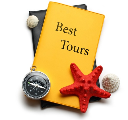 Compass, seastar and seashells on best tours brochure photo