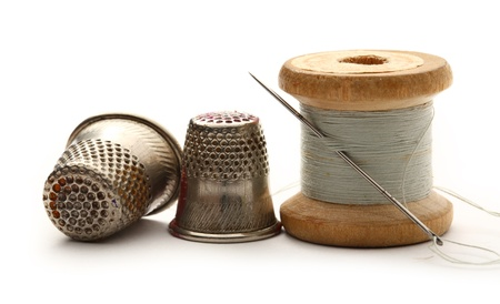 sewing item: Sewing thimbles, bobbin and needle