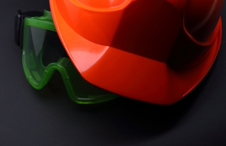 Red safety helmet with goggles on black  photo