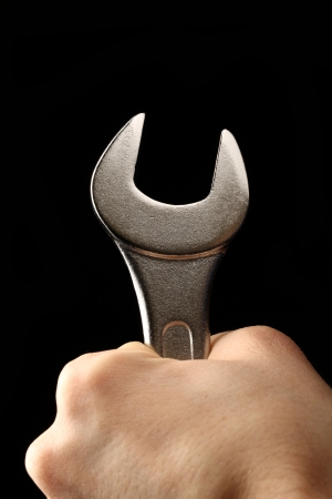 Metallic wrench in male hand photo