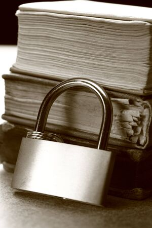 Pile of old books and keylock  photo