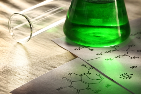 Green chemistry with reaction formula Stock Photo