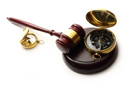 proceeding: Judges wooden gavel and compass