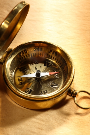 yellowed: Vintage compass on blank yellowed paper