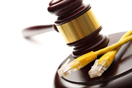 Yellow cable and wooden gavel photo