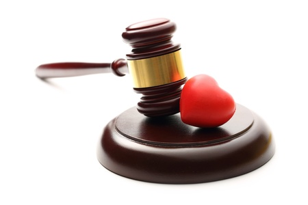 Judges wooden gavel and red heart photo
