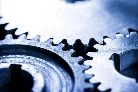 interlink: Three steel cogwheels in connection